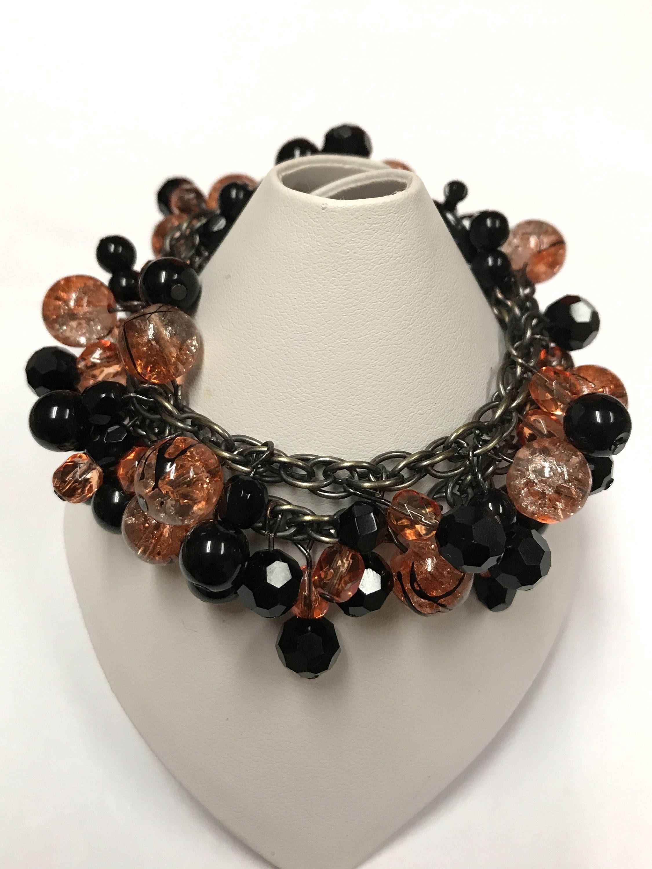 Black and orange halloween bracelet by esseniqueartsjewelry on etsy