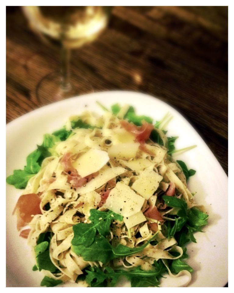 Truffle linguine in a tarragon white wine sauce. Tossed with jamón serrano and arugula.