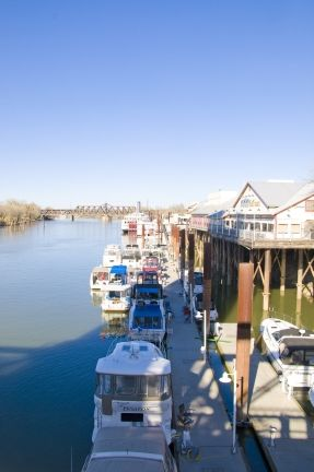 Boats Are Moored Near Joe S Crab Shack And Several Other Waterfront Restaurants