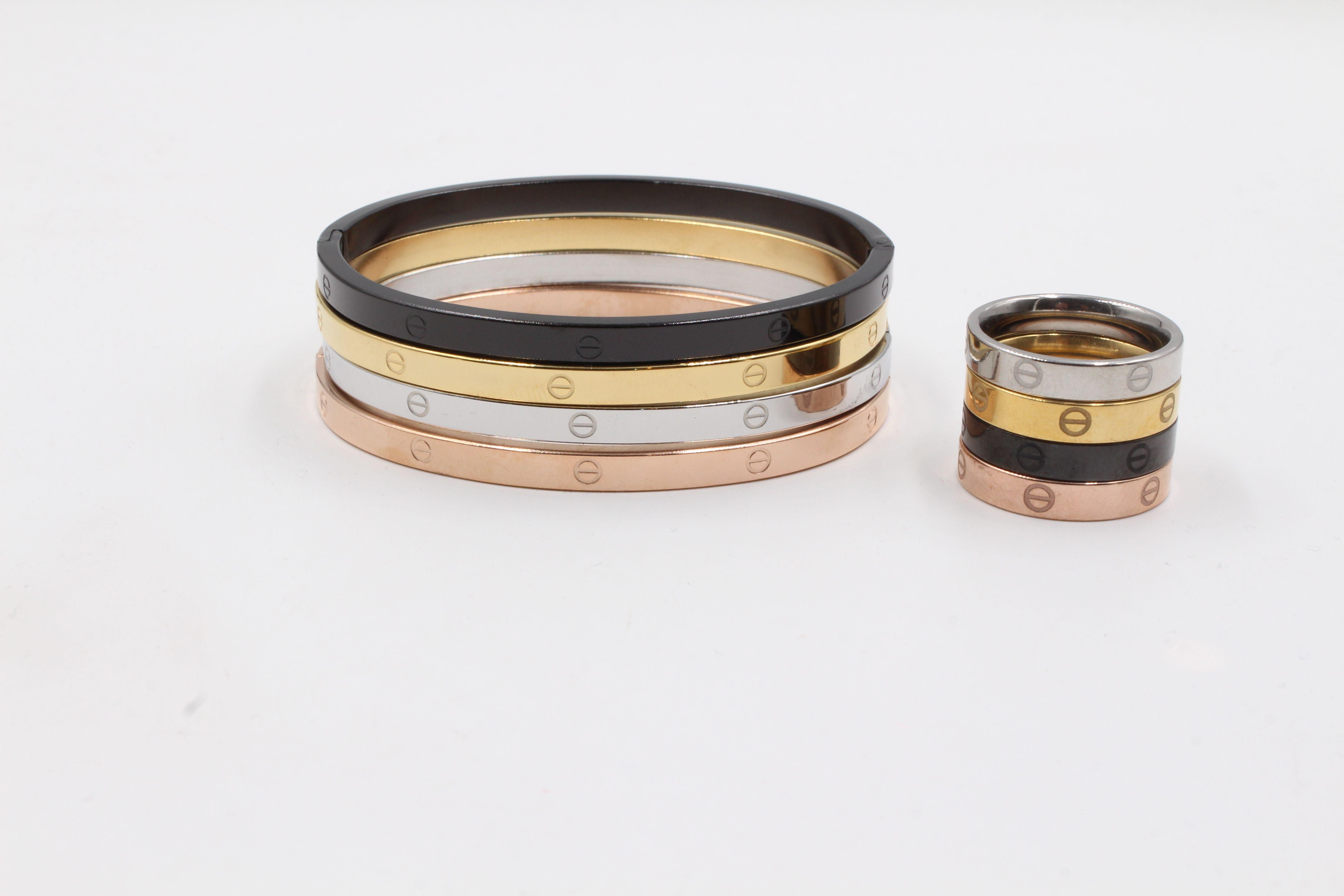 اساور خواتم كارتير طقم 8 قطع مكونه من 4 قطع اساور و4 قطع خواتم ملونه باللون الفضي والذهبي والنحاسي والاسود قابله Rings For Men Wedding Rings Engagement Rings
