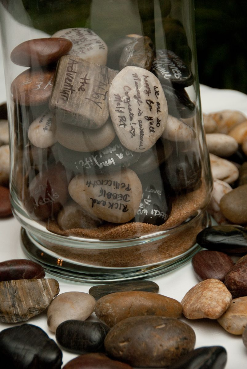 Throw out the traditional guest book Have guests sign memory rocks instead  Wedding