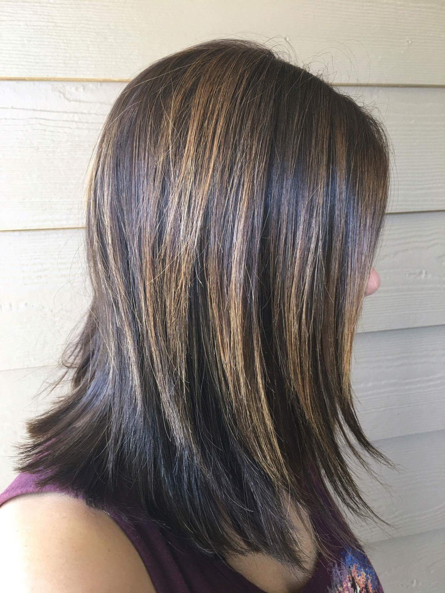 Edgy shattered layers and brunette balayage by yogahairdresser