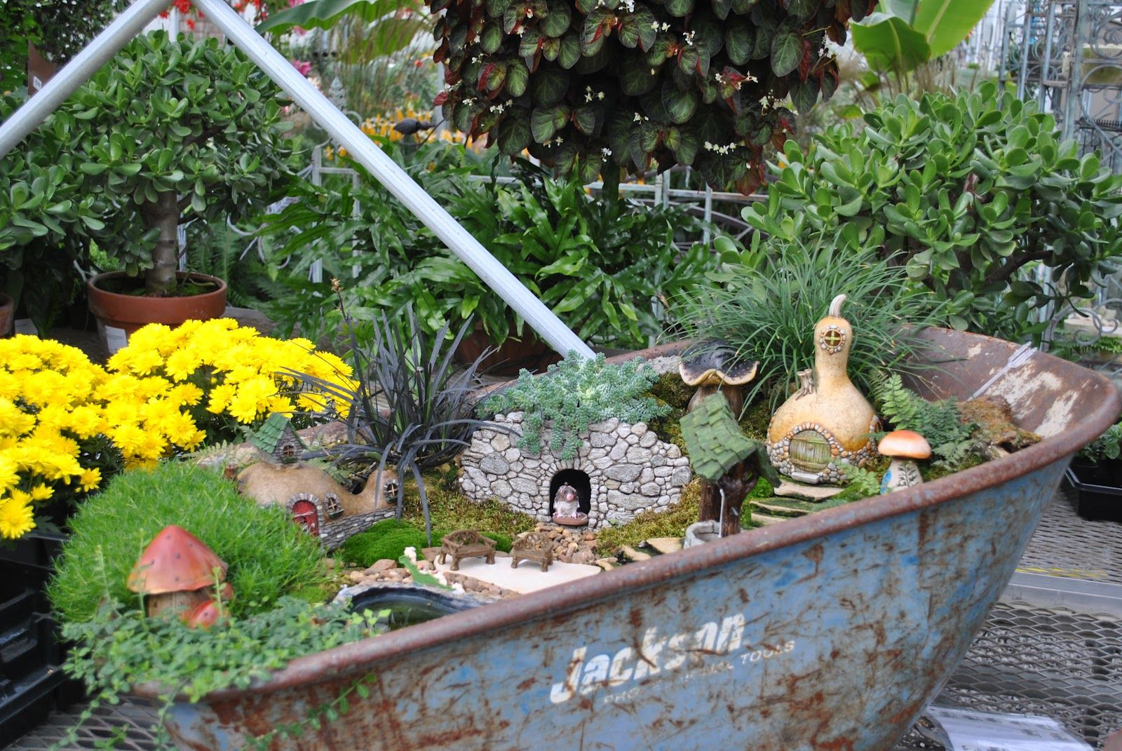 ... fairy garden. The next two pictures are some close ups of the wheel