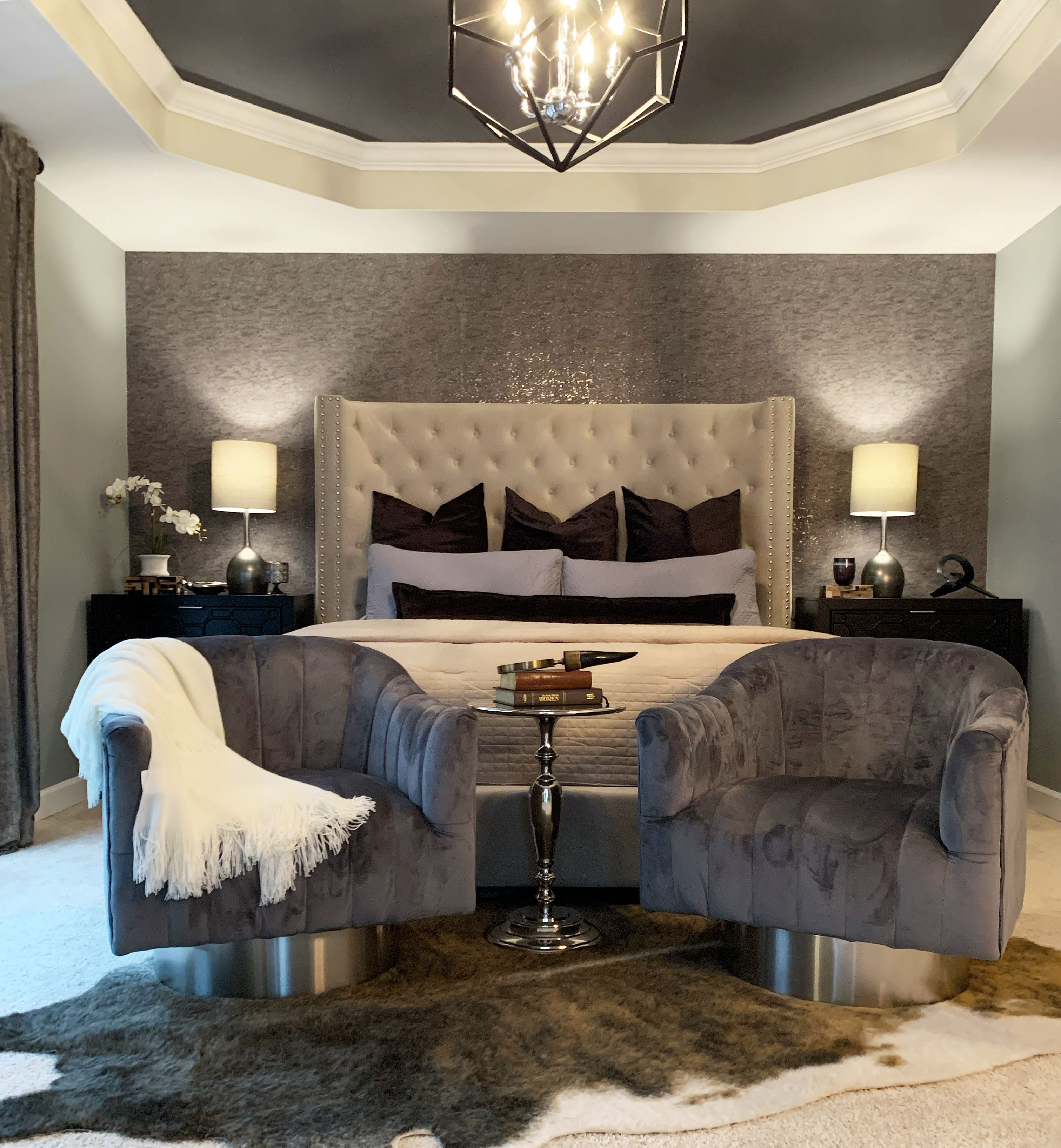 Neutral bedroom decor with faux cork wallpaper accent wall