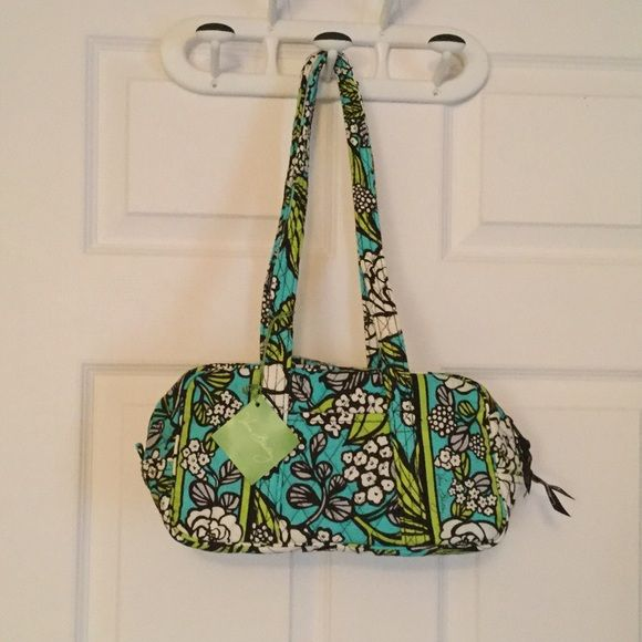 Vera Bradley Island Blooms Handbag NWT NWT. Zipper closure, with 1 pocket on the outside.  6 small pockets on the inside. 14 inches long and 6 inches high. Straps are shoulder straps. Vera Bradley Bags Shoulder Bags