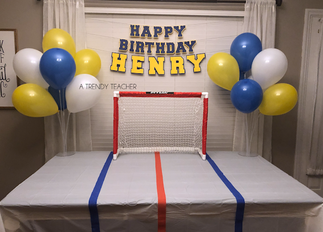 First Birthday Hockey Party Cake Smash St Louis Blues One Year Old Photos Hockey Party Hockey Birthday Parties Hockey Birthday