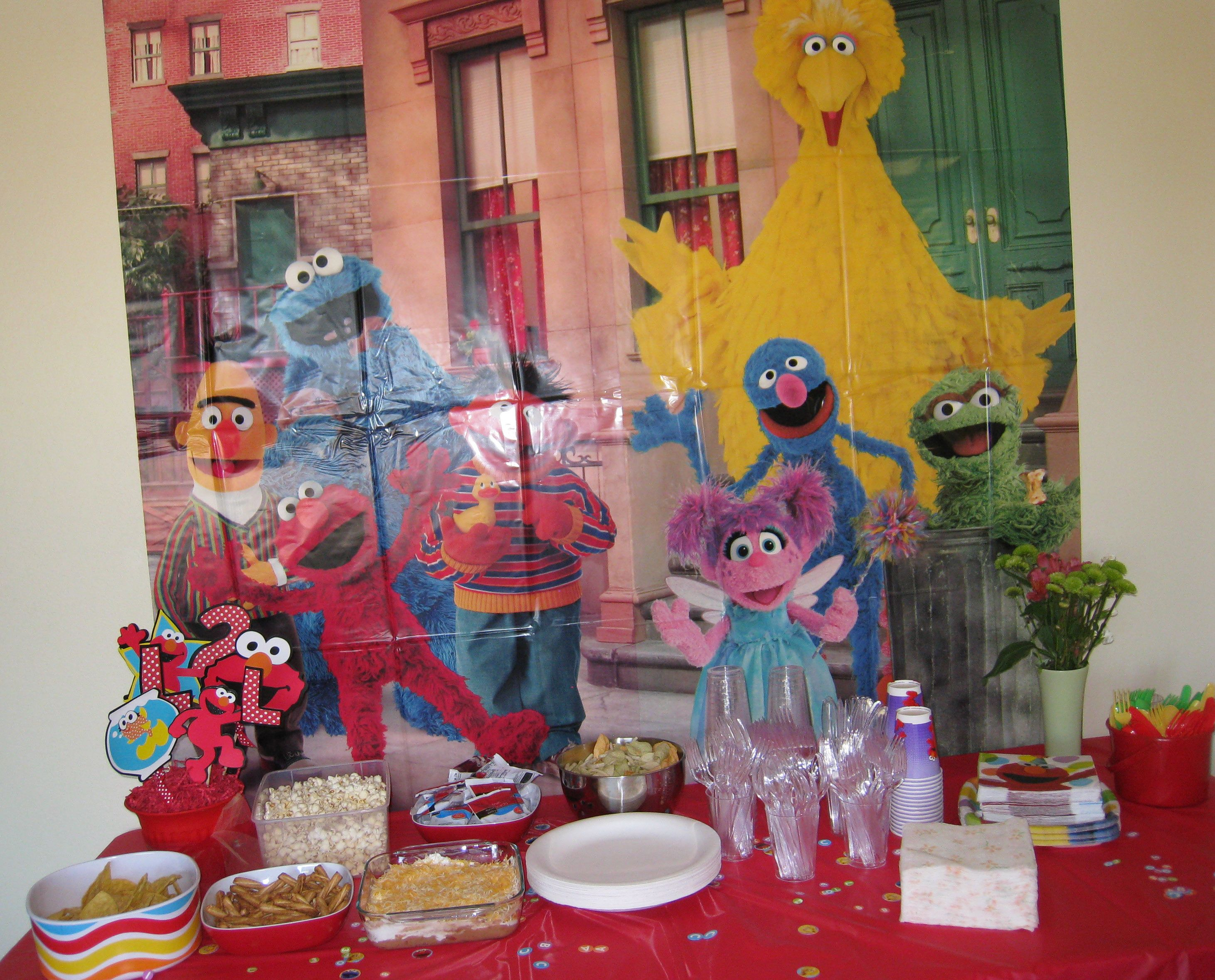 Food table with Sesame Street backdrop purchased at Party City and