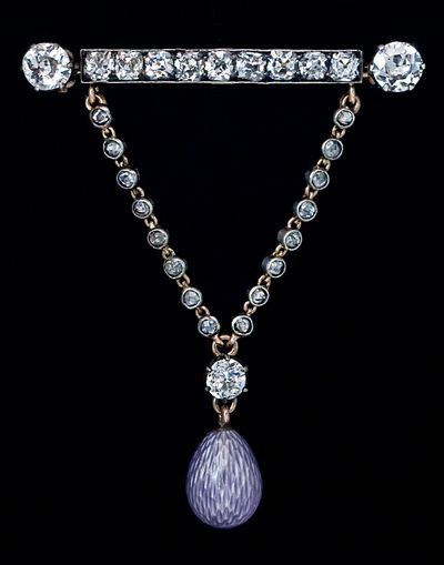 A very stylish and unique antique diamond brooch / pin with guilloche enamel egg charm, Russian, circa 1900.    Unmarked, attributed to Peter Carl Faberge.    A beautiful lavender purple guilloche enamel egg with a silver luster, hanging on a rose diamond encrusted chain held by a diamond set bar pin.    The bar pin is set with a row of nine single cut diamonds and accented with two Old European diamonds at the ends. All diamonds are set in silver over rose gold