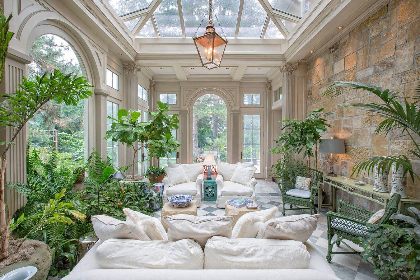 Traditional Sunroom Blends Indoor & Outdoor Greenery