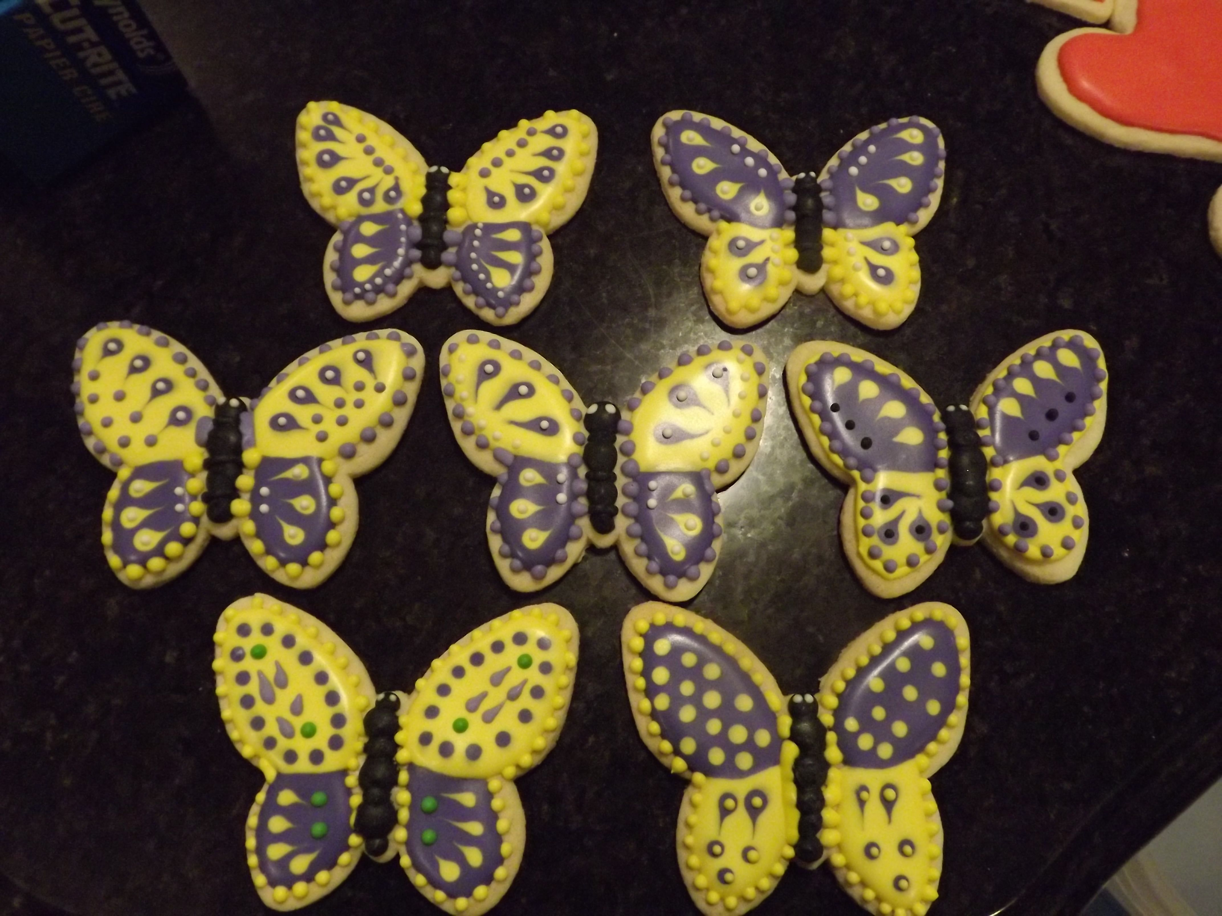 Purple and Yellow Butterflies...Log House Cookies #cookies #royal_icing #butterflies #purple #yellow