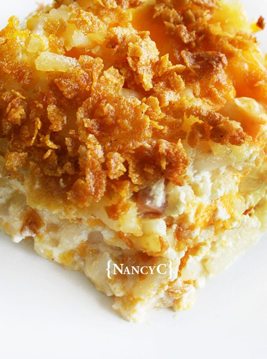 Makes a 9×13″ pan of potatoes, about 10 to 12 servings 2 lbs. frozen hash browns, thawed 3/4 cup (1 1/2 sticks) butter, melted and divided 1/4 teaspoon pepper 1 teaspoon salt 1/2 cup chopped onion or green onion (Jane Ann substituted dried minced onion) 1 (10 3/4-ounce) can cream of chicken soup (or substitute cream of celery soup) 1 pint (2 cups) sour cream (regular or light) 2 cups shredded sharp cheddar cheese 2 cups crushed corn flakes Preheat oven to 350 degrees. Grease or spray a 9×13″ pa