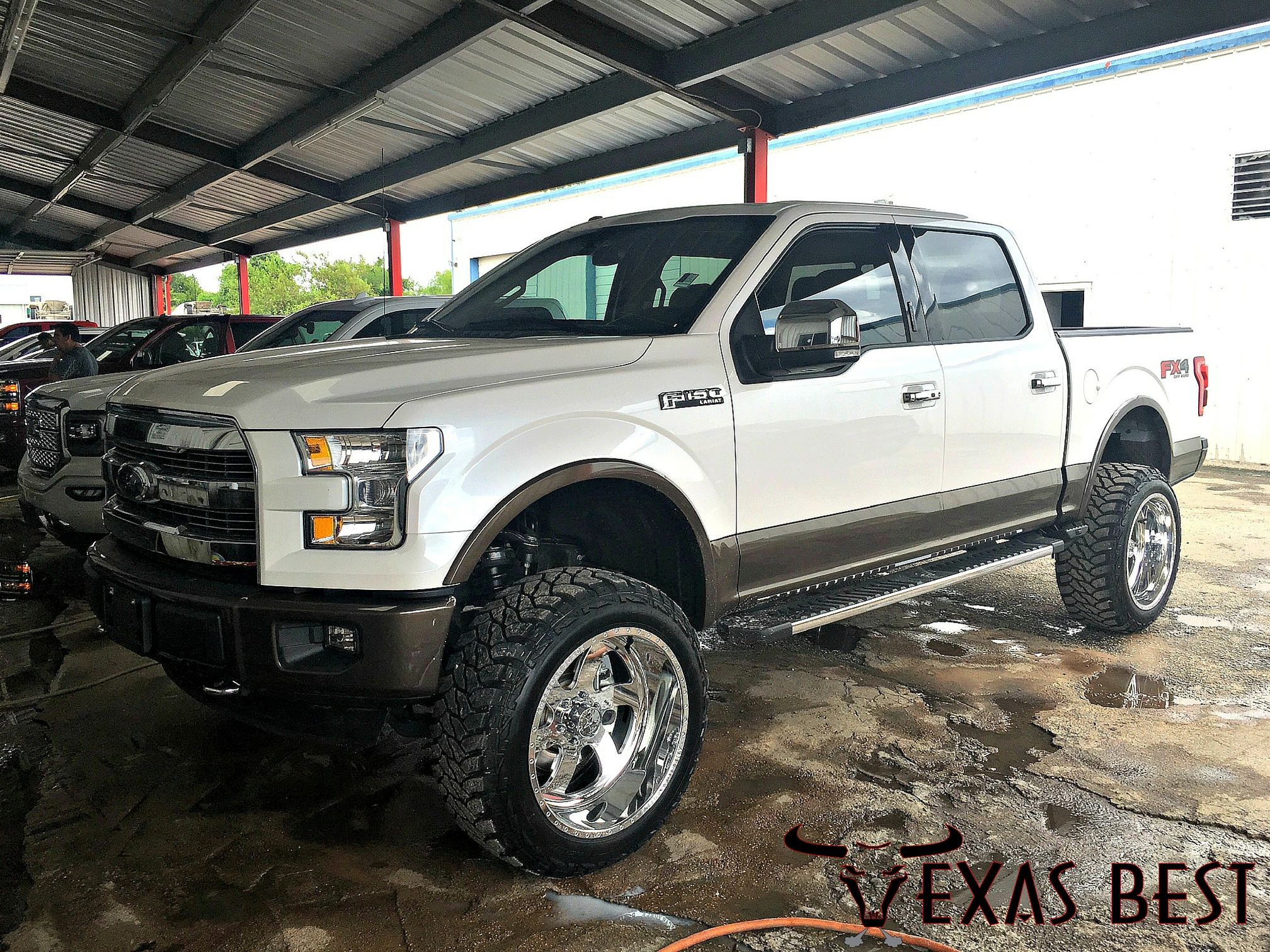 "Lifted 2015 Ford F150 Lariat on custom 22"" American Force"