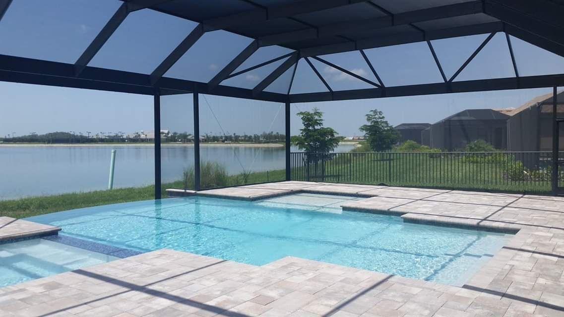 Mansard Roof Screen Pool Enclosure With A Picture Window Design Limited Obstruction To Fit Your Hom Backyard Pool Designs Pool Screen Enclosure Backyard Pool