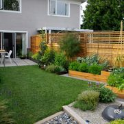 Raised planter bed garden along exterior fence - use mesh to keep the dogs and cats out - Aloe Test Garden - contemporary - Landscape - Vancouver - Aloe Designs