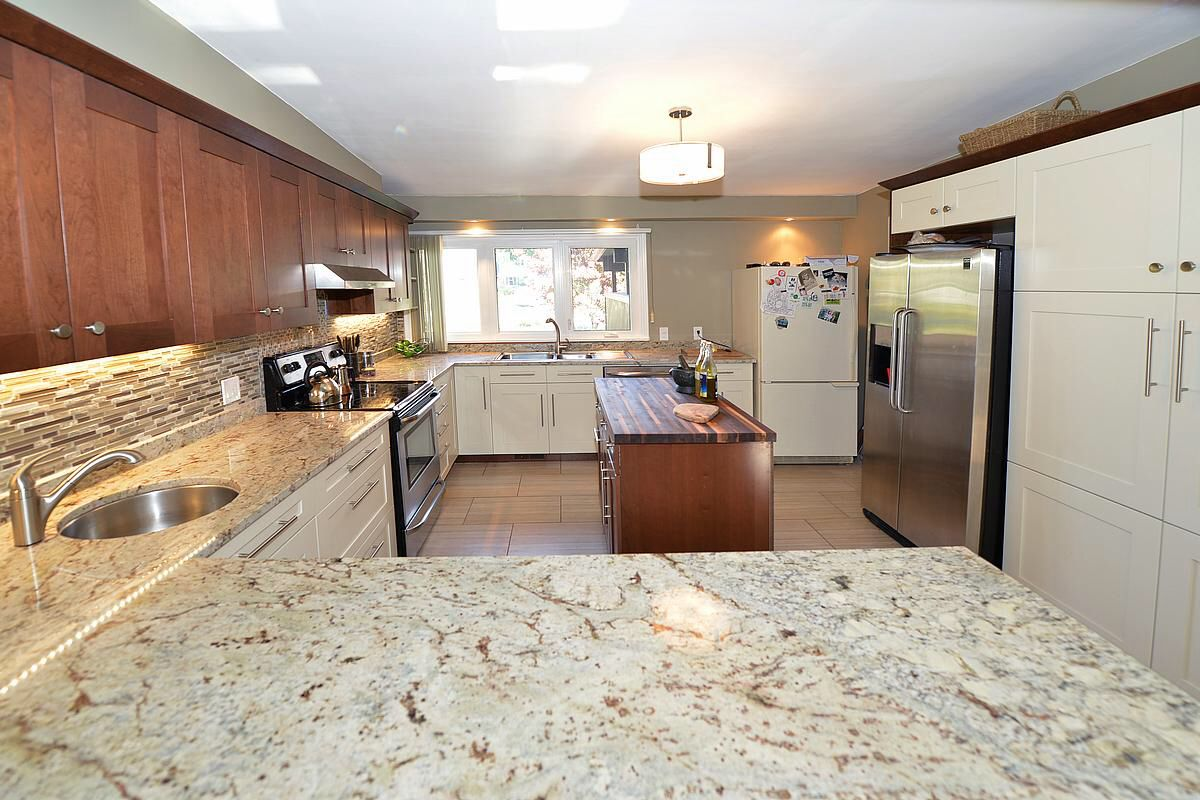 Typhoon Bordeaux granite countertops | 6050 Clare cres., Niagara ...