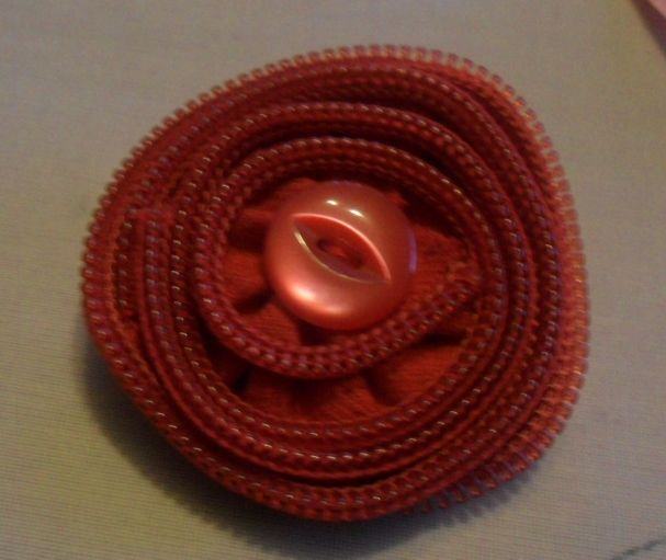 red zip brooch with button