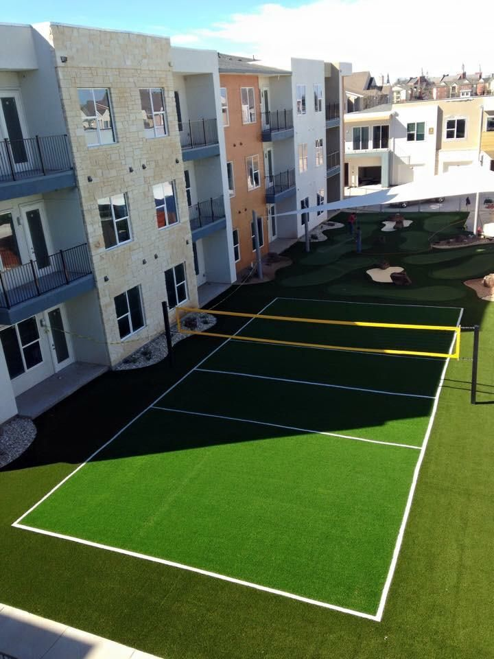 Padded Turf Volleyball Court And A 9 Hole Putt Putt In Waco Tx At A Student Housing For B Artificial Grass Installation Backyard Putting Green Synthetic Grass