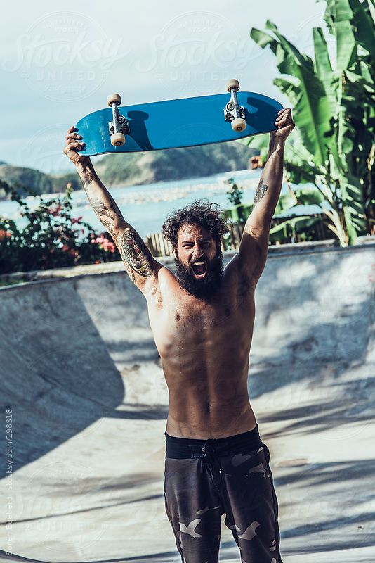 Bearded skater with tattoos holding skateboard in concrete pool vk bearded skater with tattoos holding skateboard in concrete pool vk beardsandchicks malvernweather Gallery