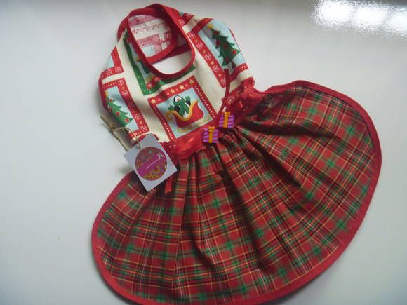 vestido confeccionado com tecido de  algodão , destaque para passa maria e botões presente, acabamento com vies e fechamento em velcro. tamanho P R$ 29,99