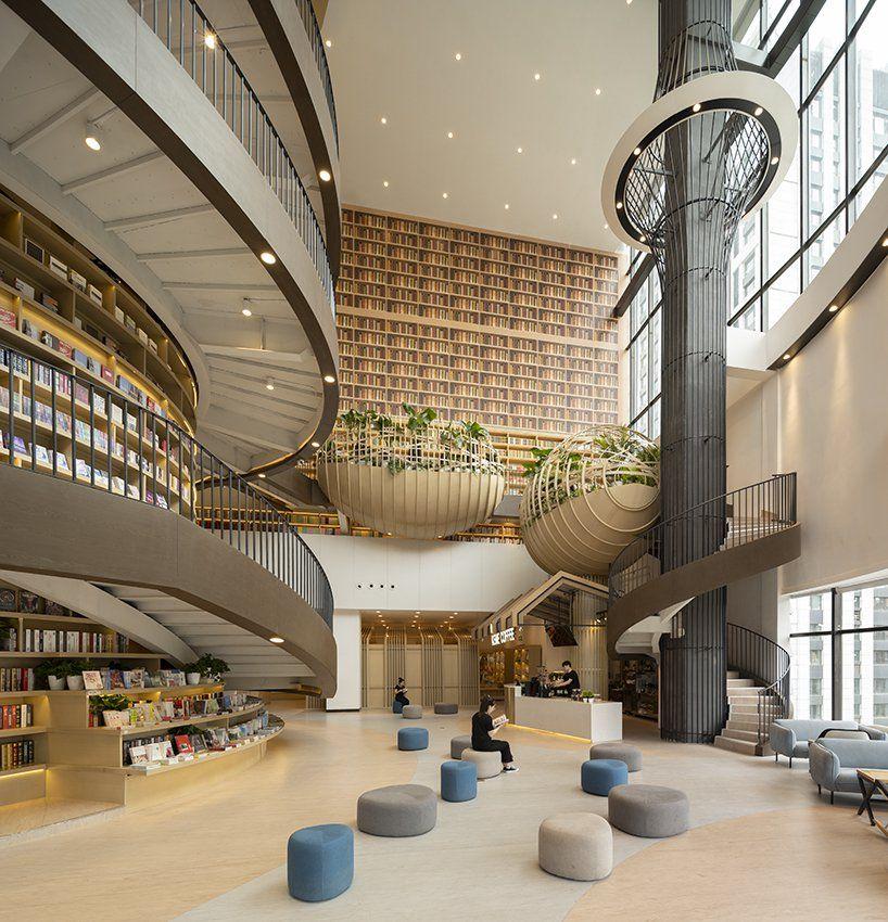 Hma Forms M I Bookstore Around A Massive Circular Bookcase In China Atrium Design Architecture Architectural Design Photography