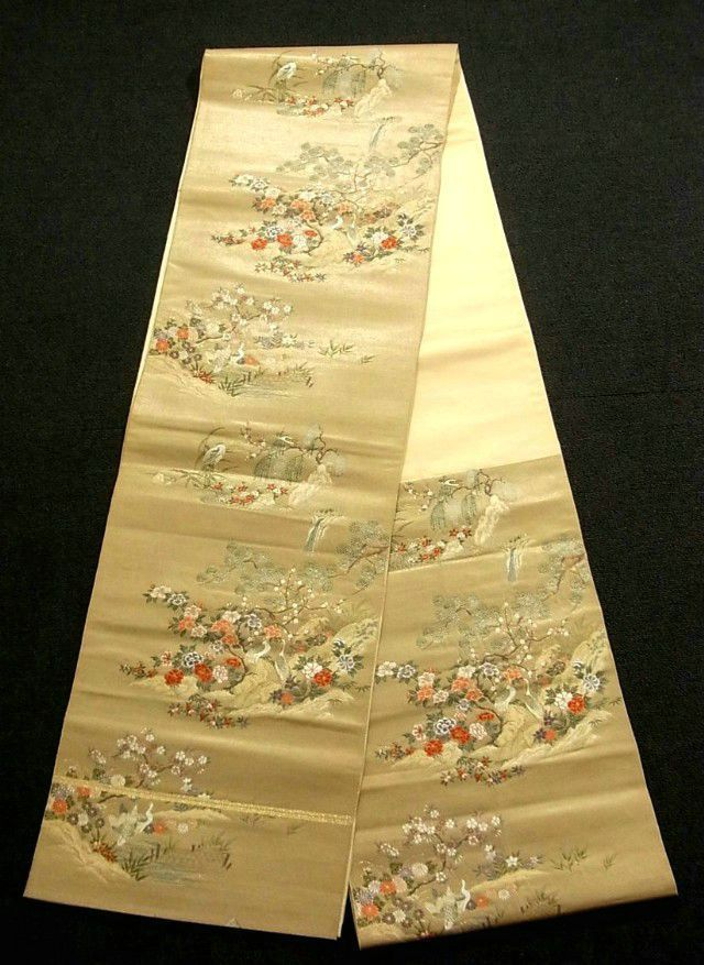 This is a gorgeous Fukuro obi with crane and seasonal flowers on stream pattern, which is woven