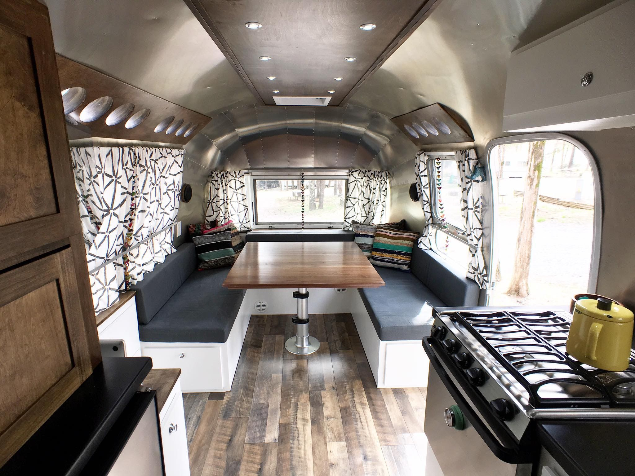 Airstream Dinette Vintage Airstream 1972 Master Bedroom/ Office/ Dinette  Loving The Bold, Graphic Curtain Print And The Contrast Of Darkers Woods  And White.