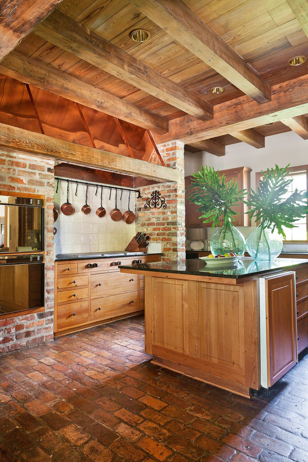 brick floor, reclaimed wood, beams, cabinets | dining