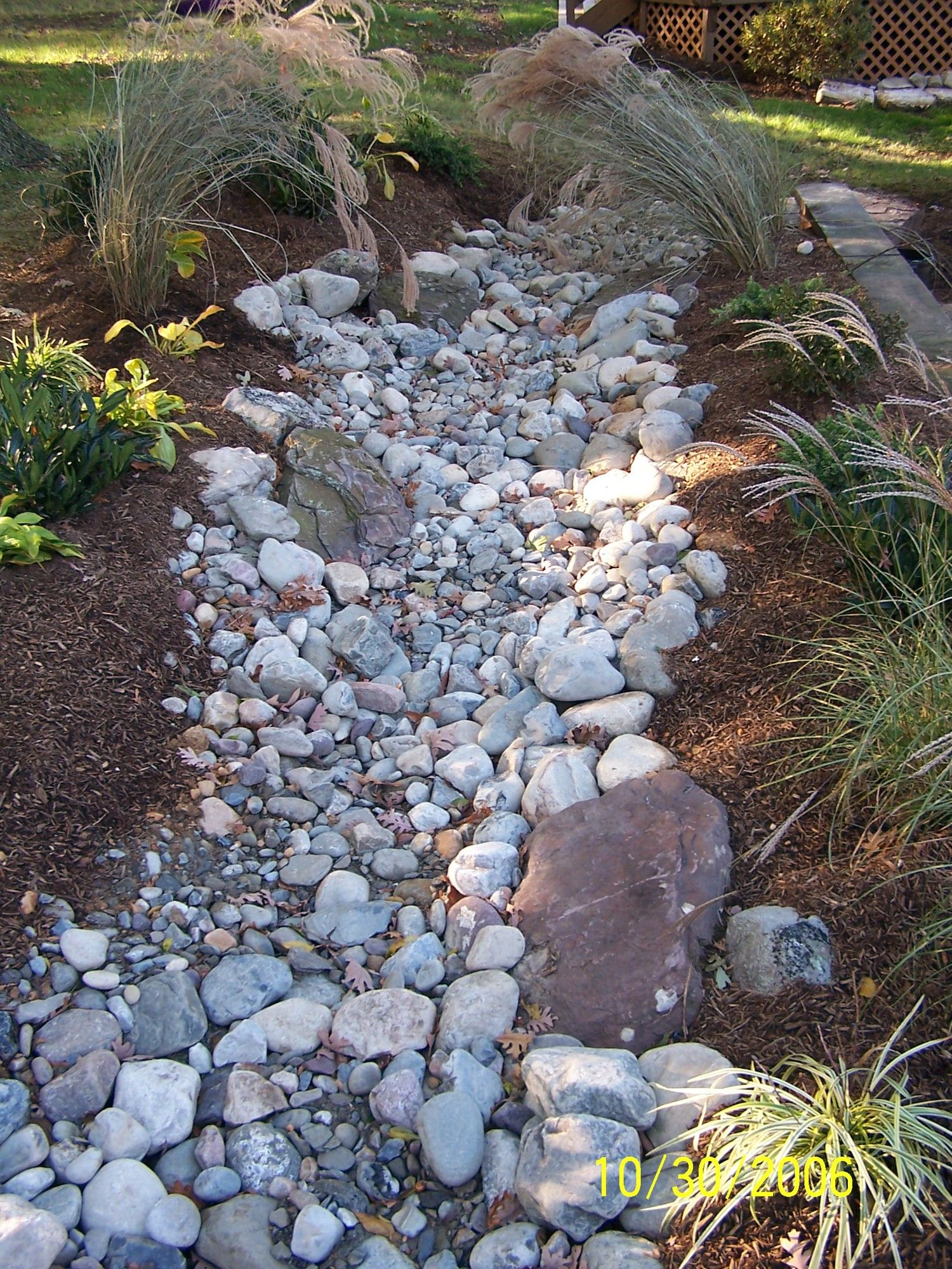 gorgeous dry creek bed design