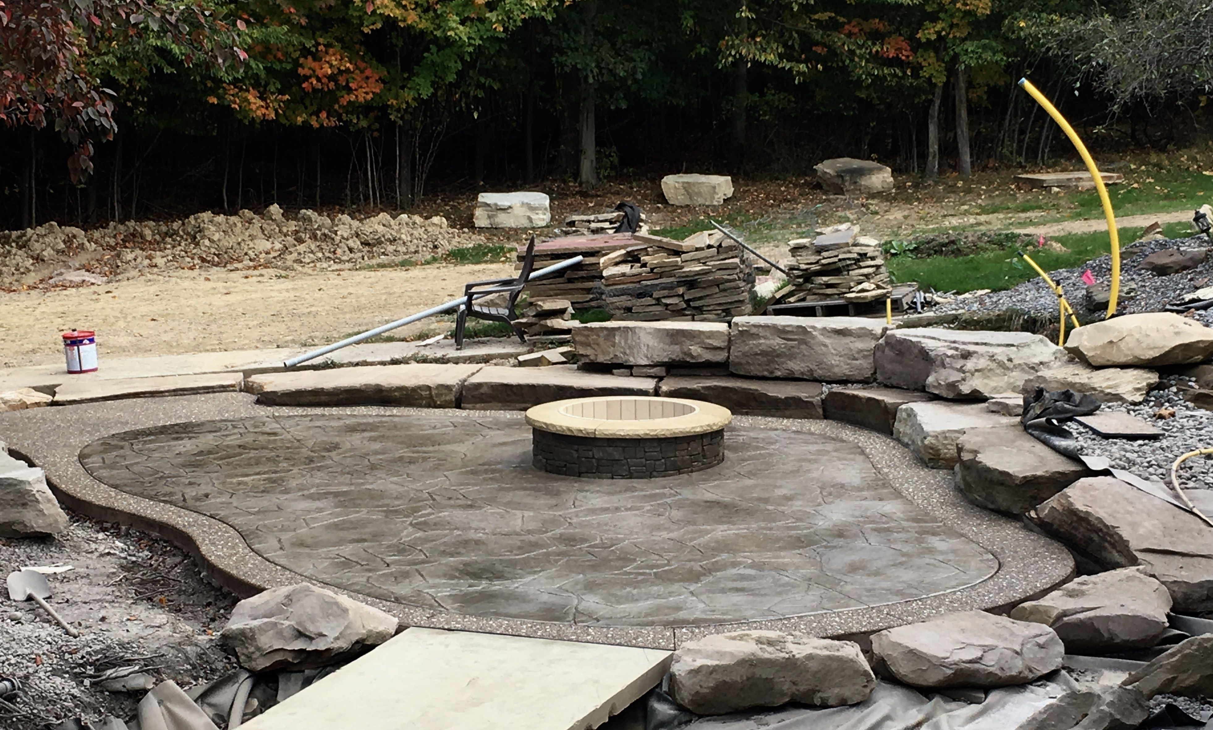 5' outside diameter stacked-stone fire pit lined w/ fire ...