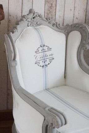 stunning French style Louis armchair throne.  The frame has been painted with an Annie Sloan Old white under coat and a Paris Grey top coat. The fabric of the chair has been painted in Annie Sloan Old White, with a detailing in Louis Blue and a stencil in #strandhuis