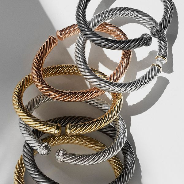 Dare to mix your metals with innovative David Yurman Cable Spira bracelets  that bend and twist