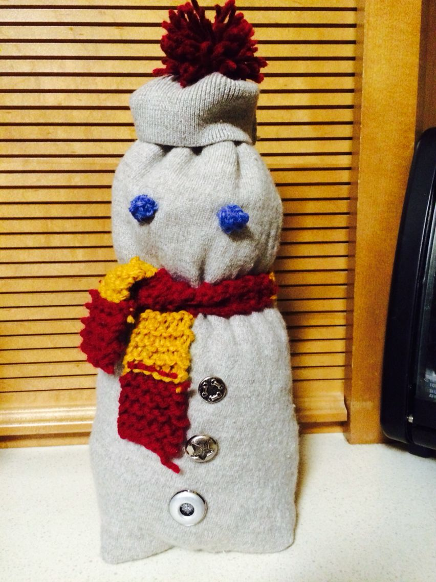 Recycled sweater snowman with Gryffindor scarf. He turned ...
