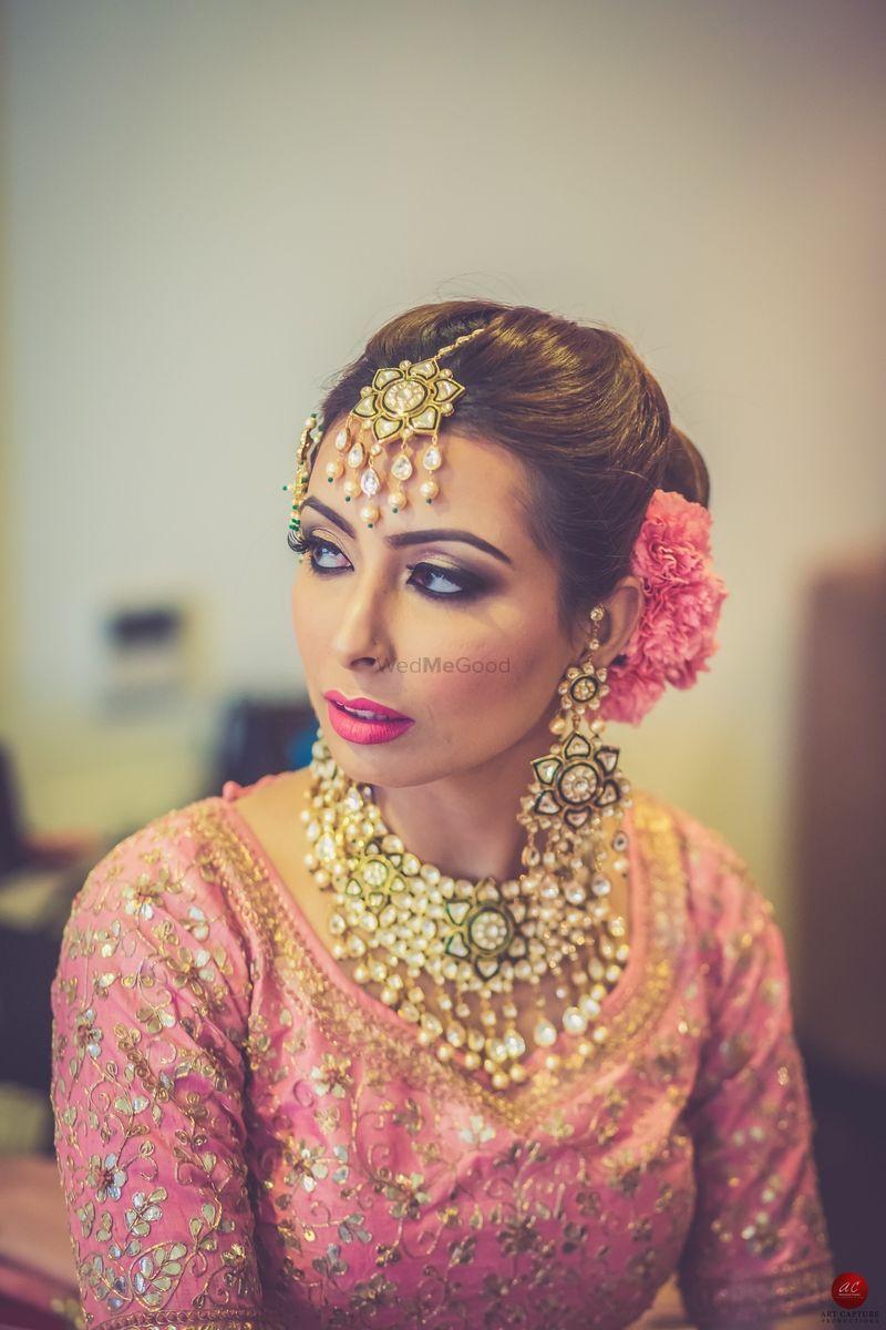 Bridal Hair And Makeup With Light Pink Lehenga Maang Tikkas
