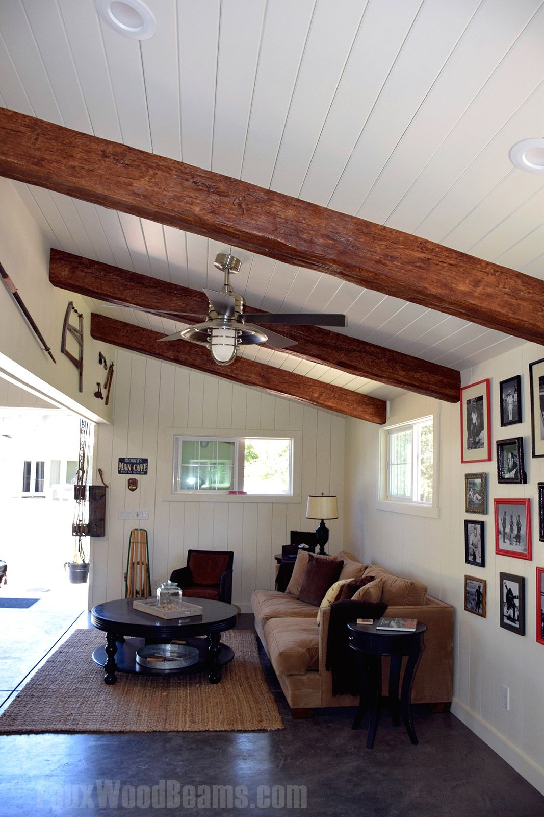 Garage converted man cave with exposed timber beams installed on a white plank ceiling
