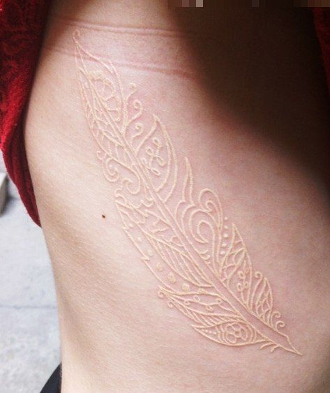 Interesting Tat With No Color Looks Like A Skin Stamp Love The Concept Not The Design White Feather Tattoos White Tattoo Feather Tattoos