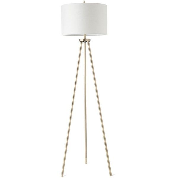 Give artistic appeal to your home with this tripod floor lamp from project the base built from slim brass posts connects to shining hardware for a