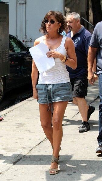 2efe2bc3fc6b30 Jennifer Aniston Tank Top - Jennifer Aniston kept cool in a white tank top  while…