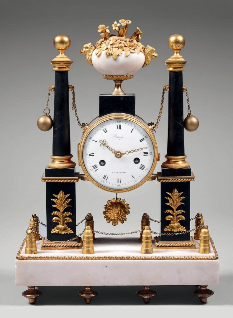 Louis Xvi Portico Clock Having Two Columnar Marble Obelisks With Ball Finials In Black Marble And Ormolu Bronze Decoration Motion Summoned From A Pendule Art