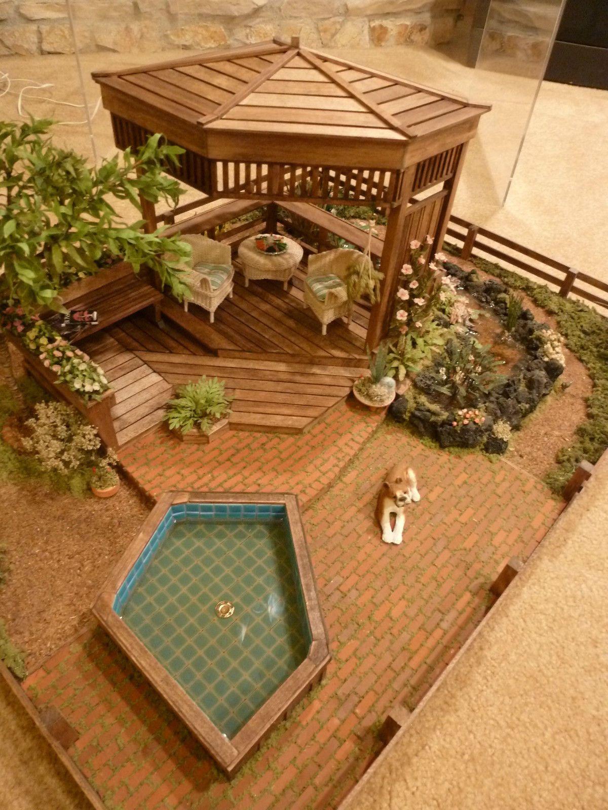 Beautiful miniature garden display gazebo, jacuzzi, flowers, trees ...