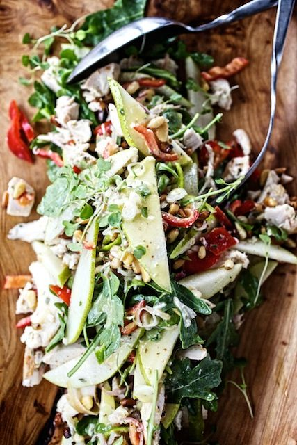 Warm chicken salad with peppers, pears and toasted pine nuts