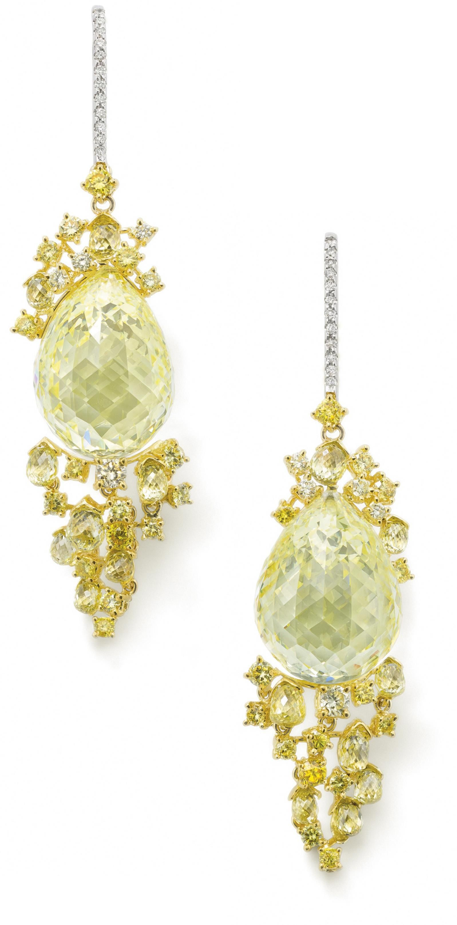 PHILLIPS : UK060111, Polished, A pair of natural fancy yellow diamond ear pendants, by Michael Youssoufian, Each designed as a central briolette-cut natural fancy yellow diamond, weighing 22.78 carats and 20.34 carats respectively, set to a briolette- and brilliant-cut coloured diamond surmount and graduating drop, pave-set diamond earwires, length 5.8 cm, remaining diamond weight 4.72 carats. Estimate £400,000 - 600,000