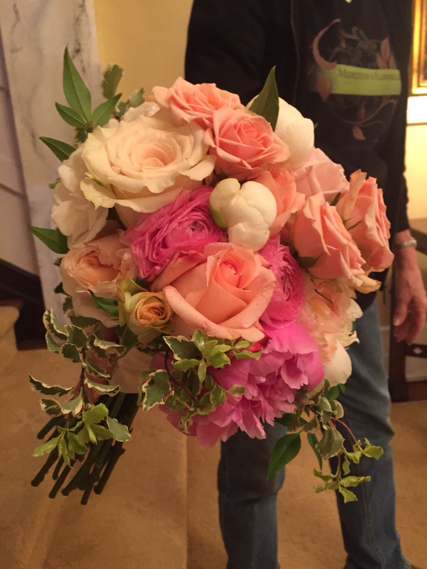 Roses and peonies in shades of pink and white with trailing jasmine