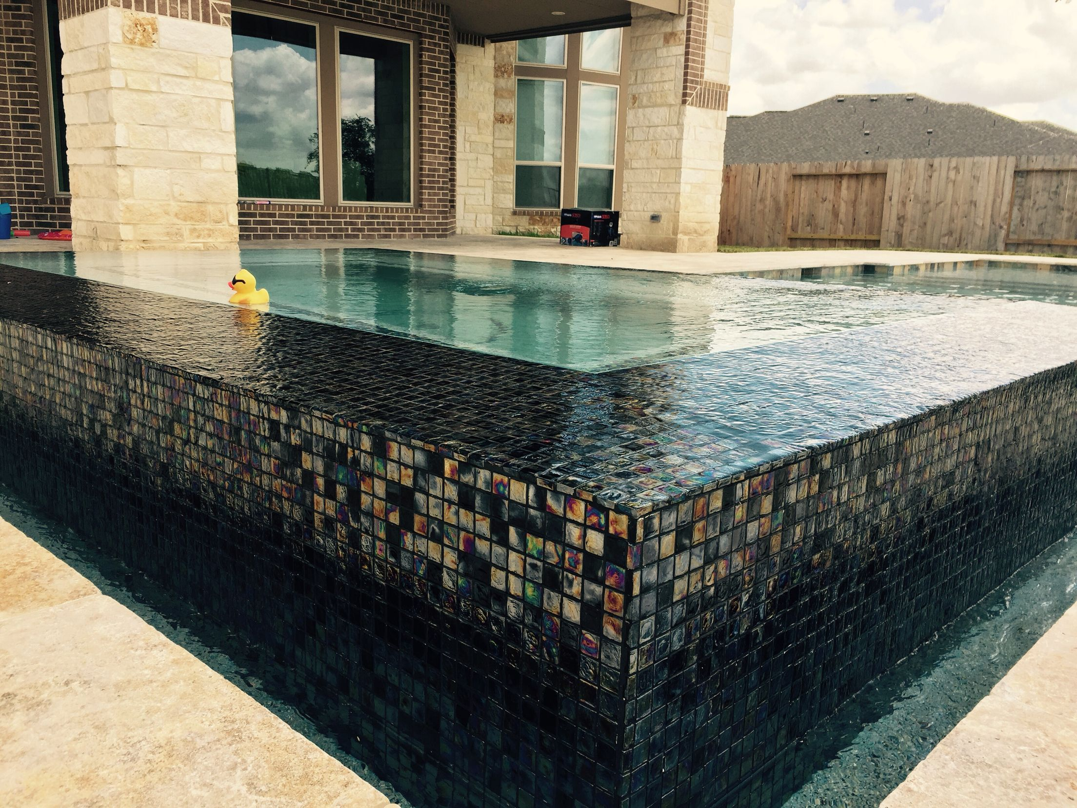 Floating spas with glass tile! Designed by: Kyle Franco - Premier ...
