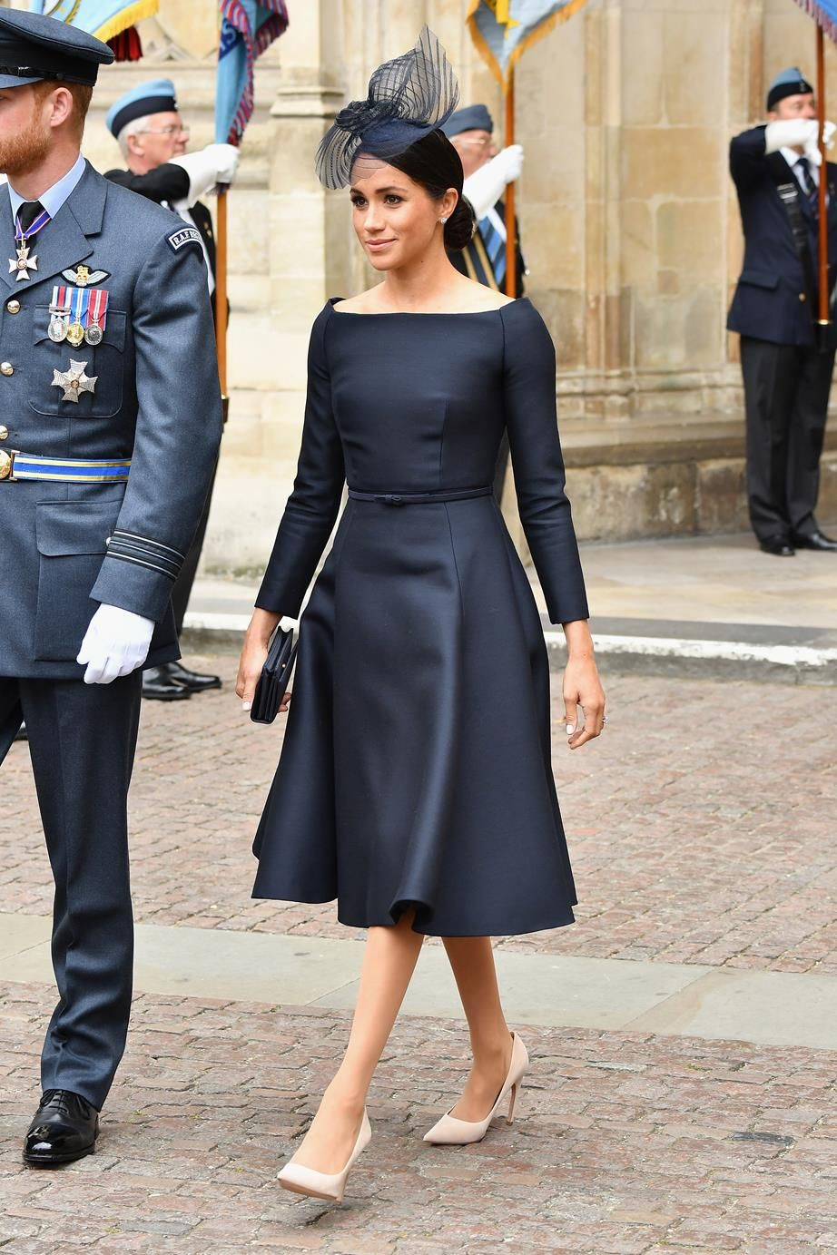 5284c54dd1ec0 Meghan Markle Steps Out In Regal Navy Dior Dress
