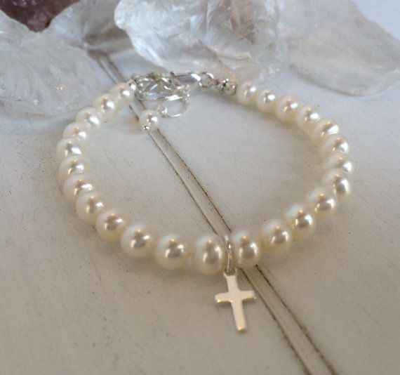This Pearl Bracelet is Absolutely adorable.    Thats all I have to say about this gorgeous infant, baby, or child baptism bracelet, made to order I only use the best AAA freshwater pearls. Can be made with a cross or heart charm. Babys first pearls are perfect for your babies special day! For a baptism, communion, christening, baby shower gift or just everyday. This is the perfect keepsake for anyone with a new baby girl, one on the way or a toddler. With gorgeous white pearls it is just…