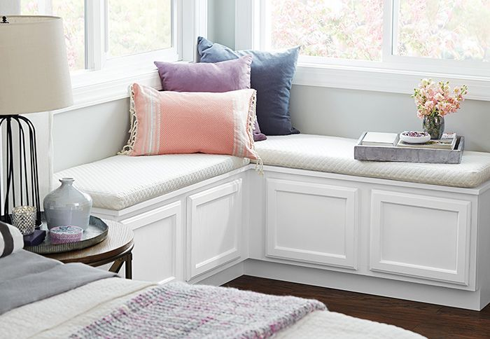 Enhance a corner window with a window seat for extra seating and