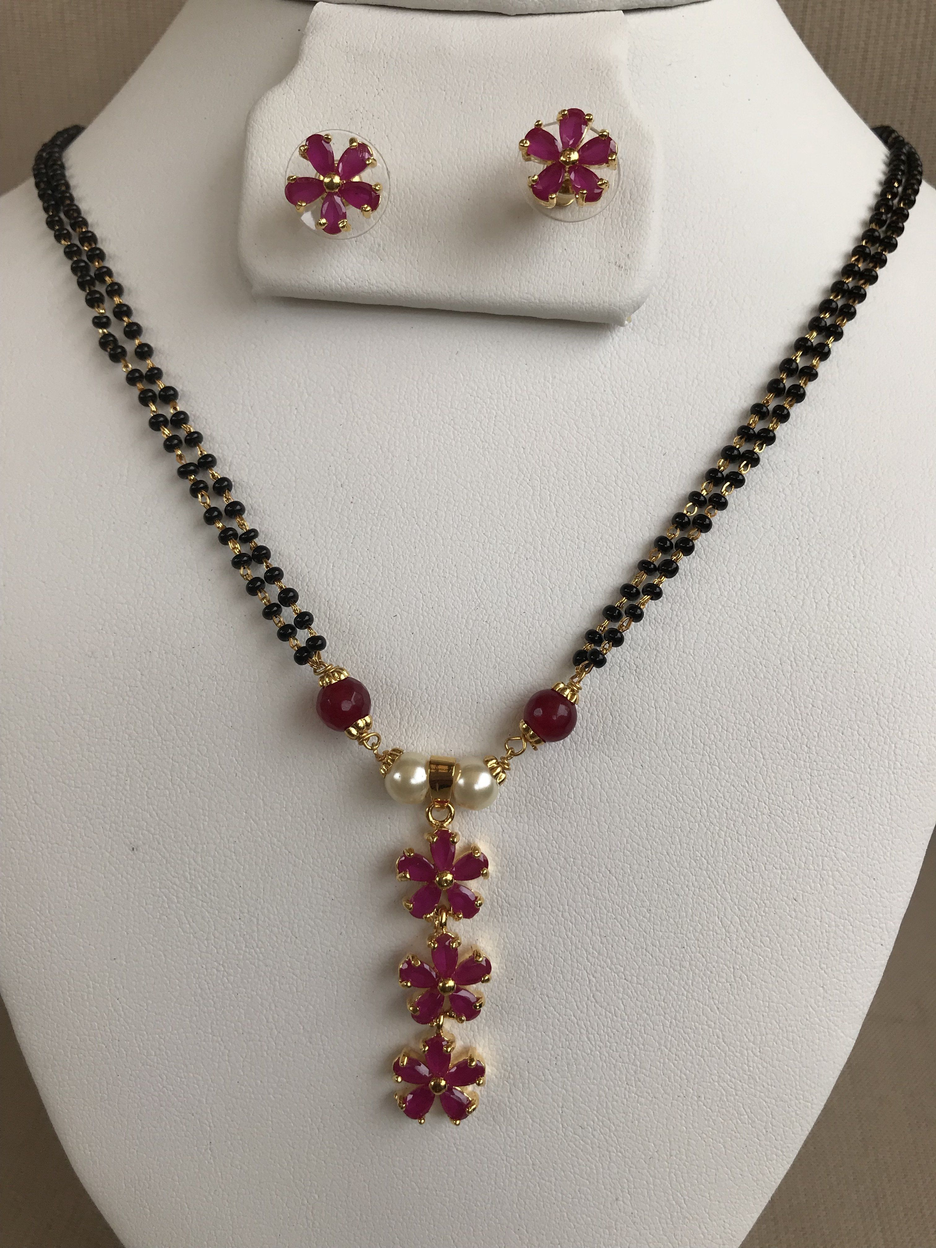 Double line black beads chain with flower design ruby pendant set