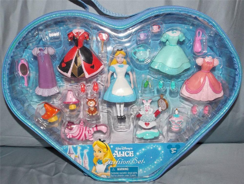 New in Collectibles, Disneyana, Contemporary (1968-Now) You are bidding on a New Walt Disney World Alice in Wonderland Polly Pocket Fashion Playset.  This set is a Disney Parks exclusive and can not be purchased at other retail stores.  ​Comes New and unopened  Set includes:  5 Dresses, 4 Pairs of Shoes, Alice Head, White Rabbit, Cheshire Cat, Mirror, Purse, Flower Tiara, Dinah, Heart Wand, Teapot, 2 Teacups, 2 Mushrooms, Un-Birthday Cake and a Bottle