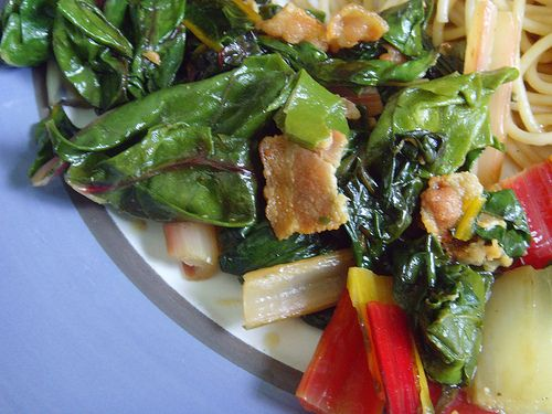 Why toss away the beautiful stems of rainbow chard? Instead, incorporate them in this lovely saute of swiss chard, bacon, and garlic. Perfect side dish.