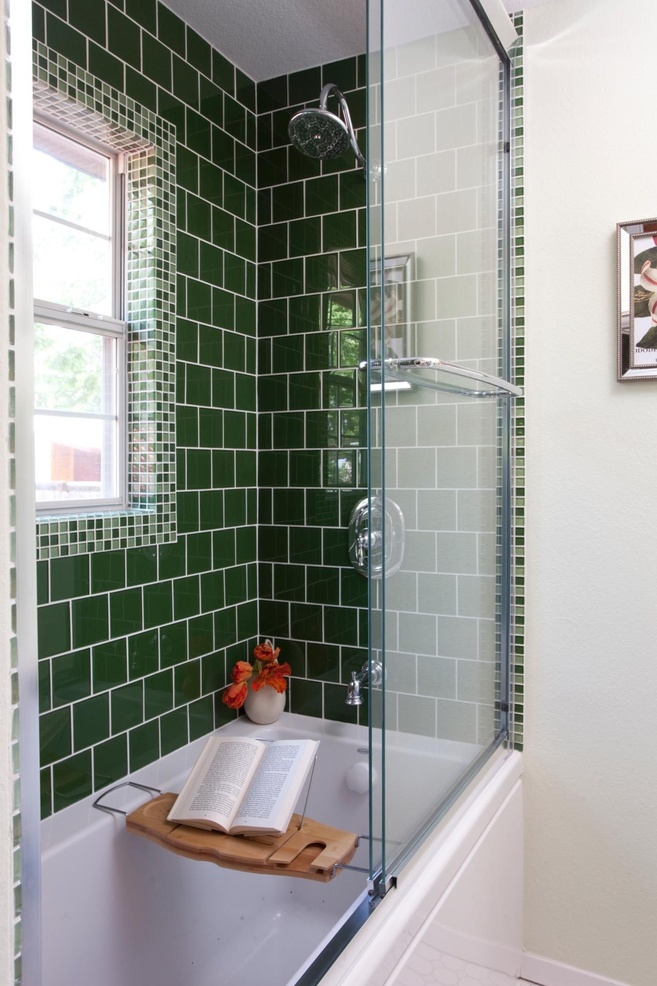A Tub Is Surrounded By Green Tile, Laid In A